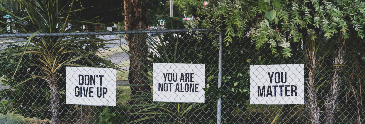 Fence with encouraging signs